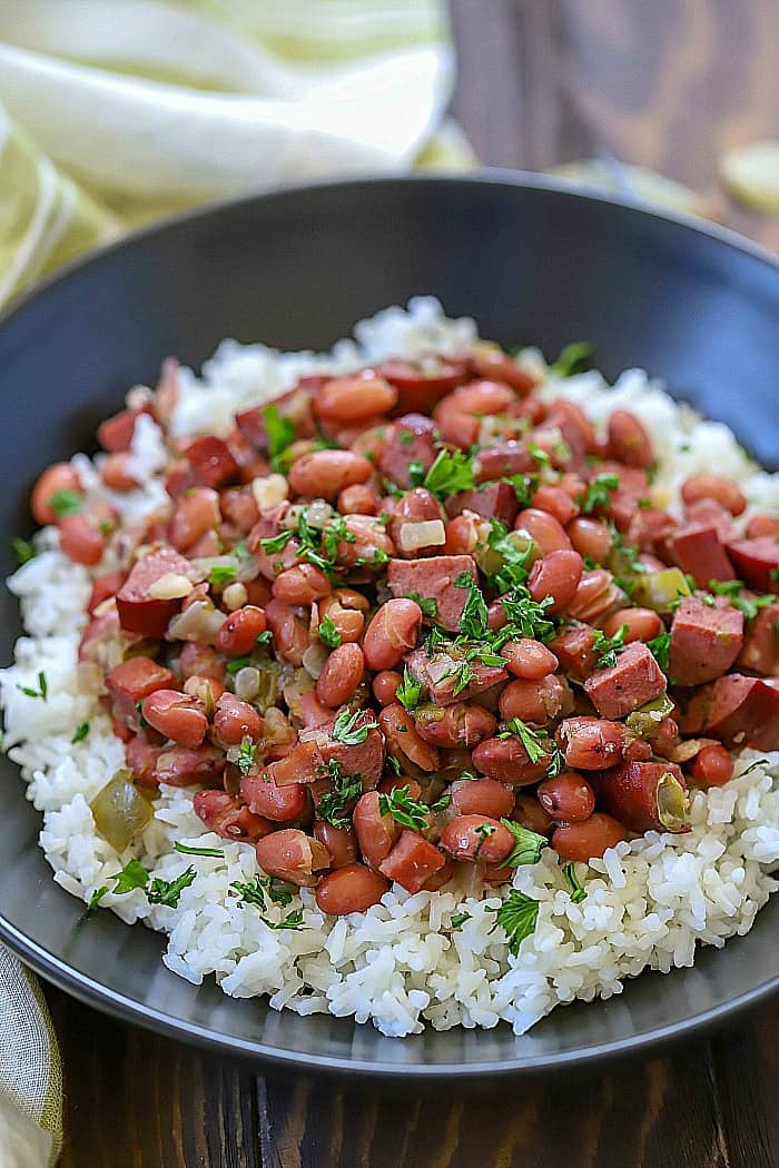 Make an incredible dinner tonight that everyone will love! These Cajun Red Beans & Rice Recipe is incredibly easy to throw together and tastes like it took a long time to make. So much flavor slow. cooked into one dish!