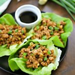 This Chicken Lettuce Wraps Recipe is seriously SO GOOD!! So much flavor in the asian inspired chicken mixture inside soft butter lettuce. Delicious!