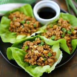 This Chicken Lettuce Wraps Recipe is seriously SO yummy! The chicken filling has delicious Asian inspired flavors with a little added crunch from the water chestnuts. This low carb recipe is great for an appetizer or a main dish.