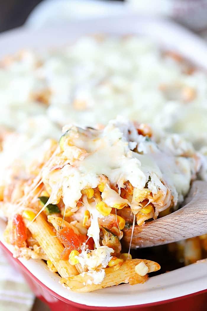 Cheese pull shot of pasta bake.