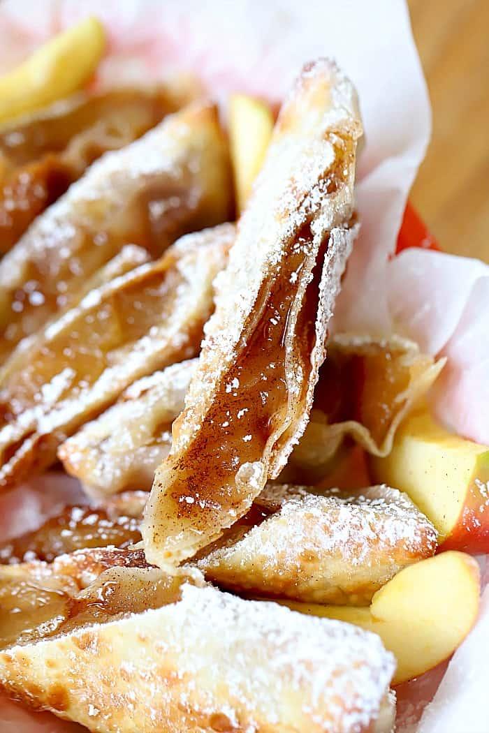 basket of powdered sugar covered apple pie eggrolls