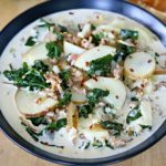 Cropped photo - Bowl filled with Zuppa Toscana Soup.