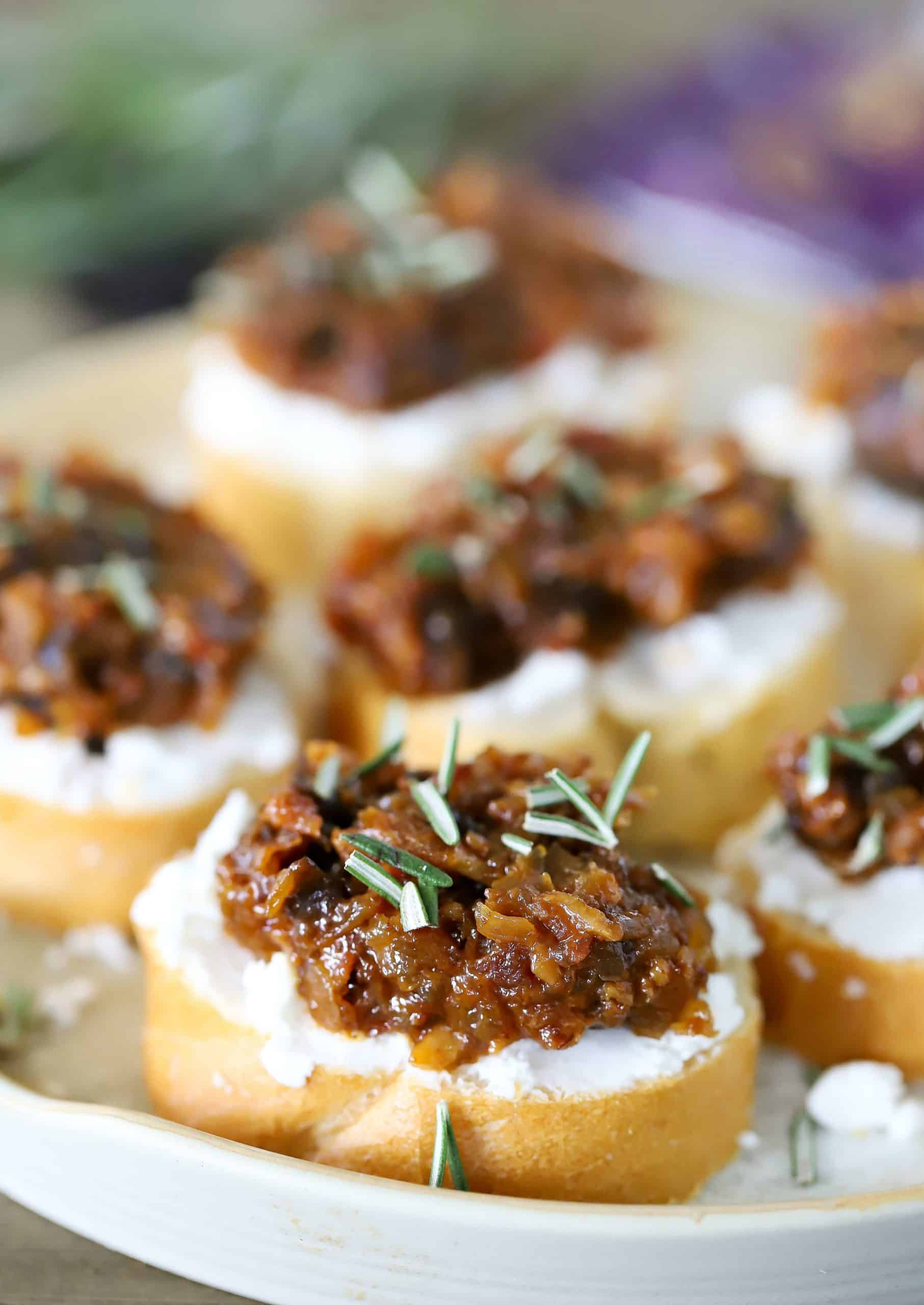 Layered Crostini's on a white plate.
