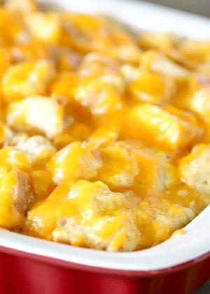 cheesy strata in a red casserole dish