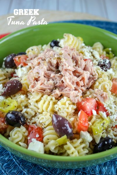 Green bowl filled with Tuna Greek Pasta Salad.
