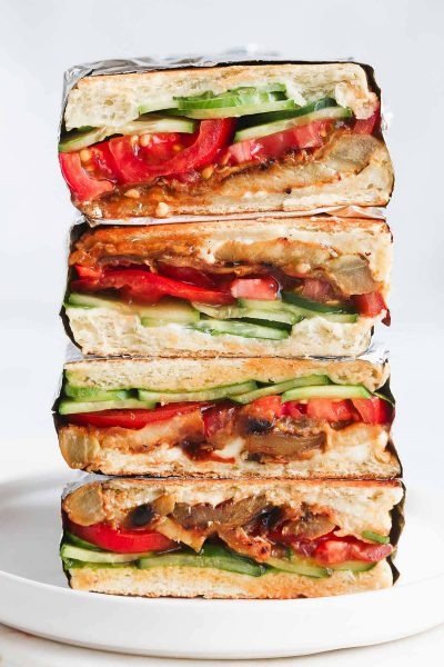 4 Vegan Eggplant Sandwich stacked on top of each other.