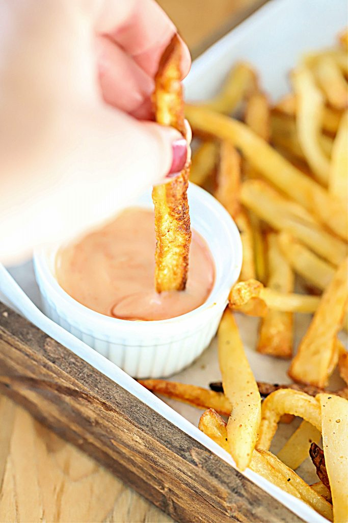 French fry dipped in fry sauce