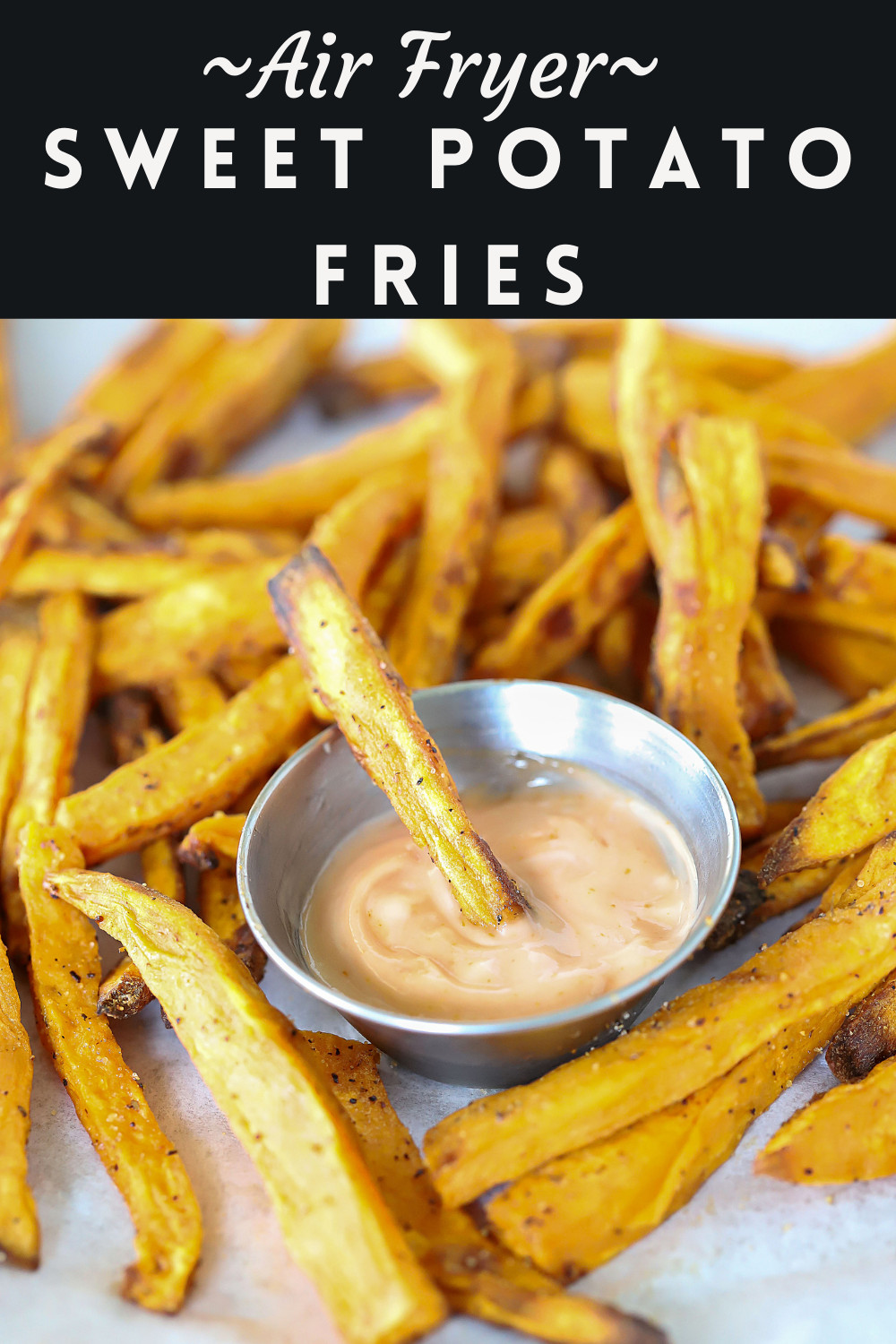 If you love French fries but want a fry that's a little different, try these Air Fryer Sweet Potato Fries! They're light, healthy and full of vitamins with a hint of sweet and salty. Such a great combination! #fries #frenchfries #sweetpotato #airfryer #easysnack #sidedish #healthy #easy #frysauce #yummyhealthyeasy via @jennikolaus